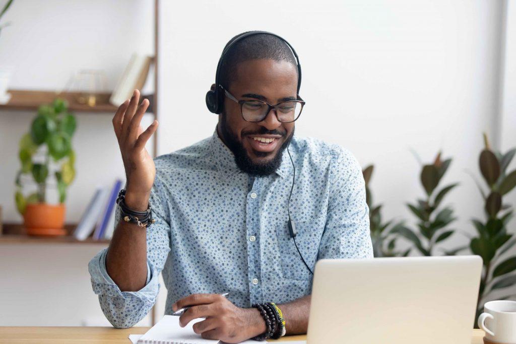 Black man watching webinar