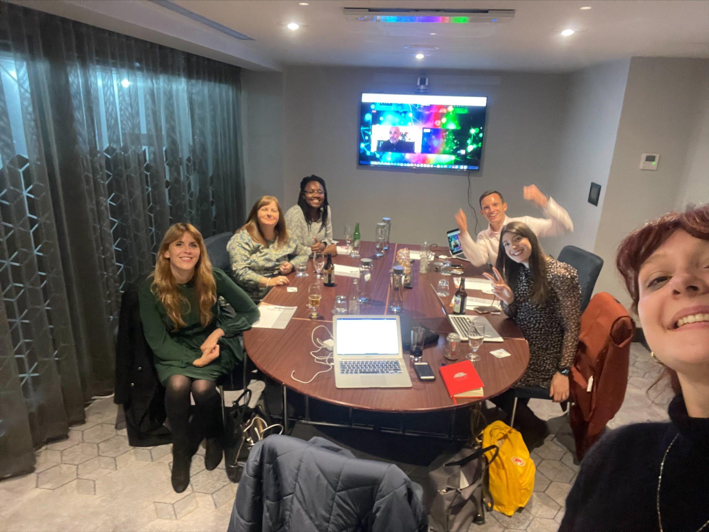 See Media team celebrate in meeting room